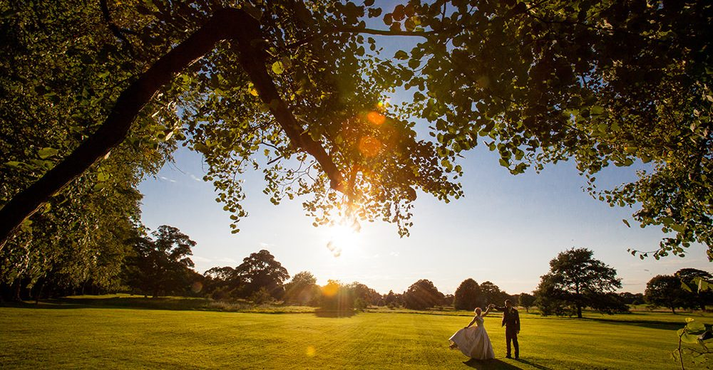 Bride and Groom dancing at sunset at Mottram Hall