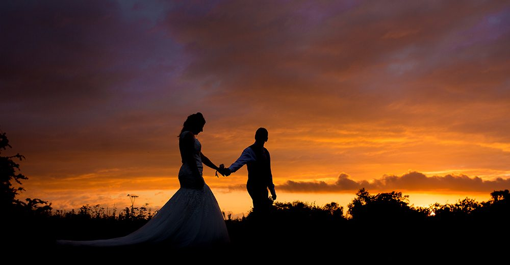 Bride and Groom at sunset at the Cock O Barton